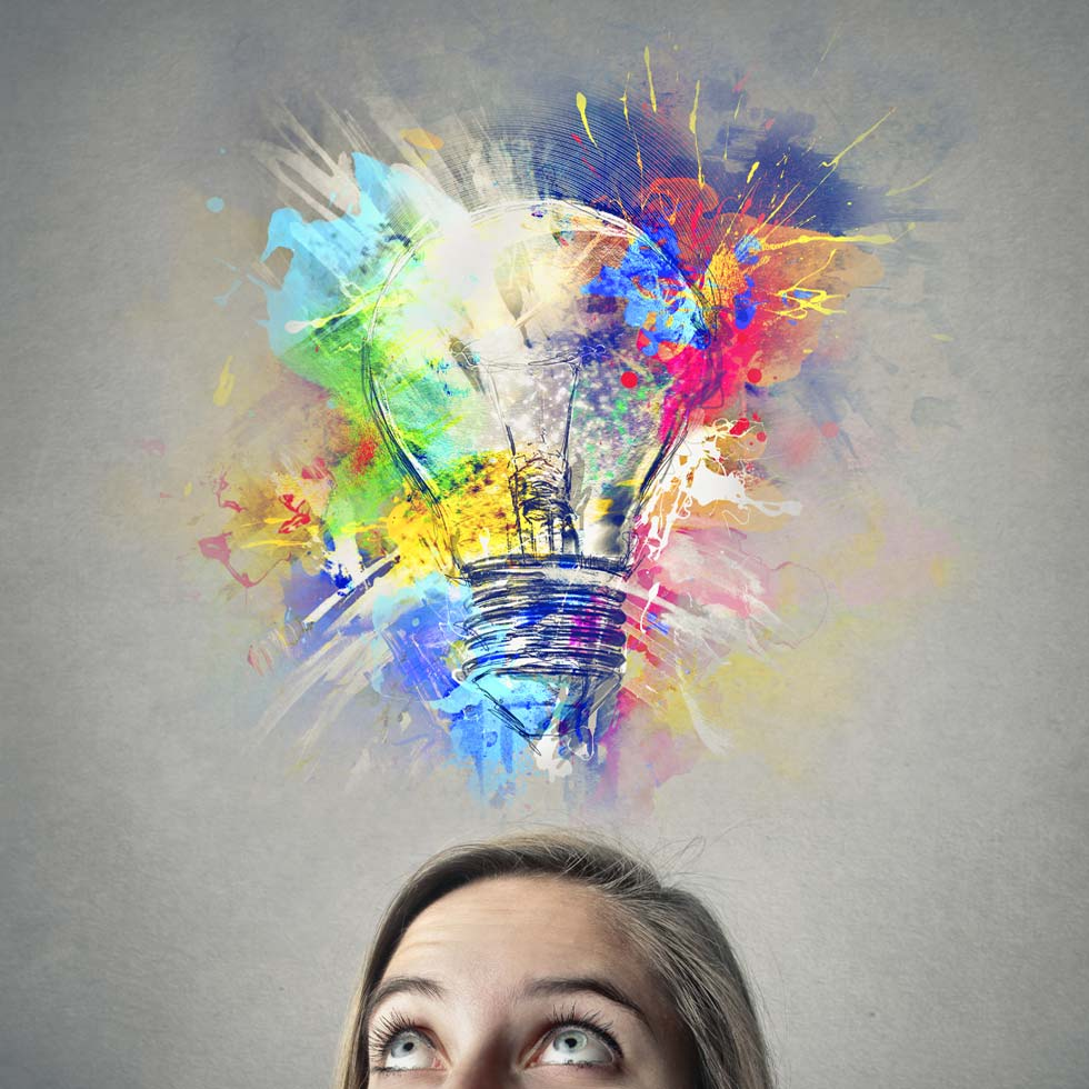 Woman With Bright Idea Showing A Light Bulb And Lots Of Color Splashes
