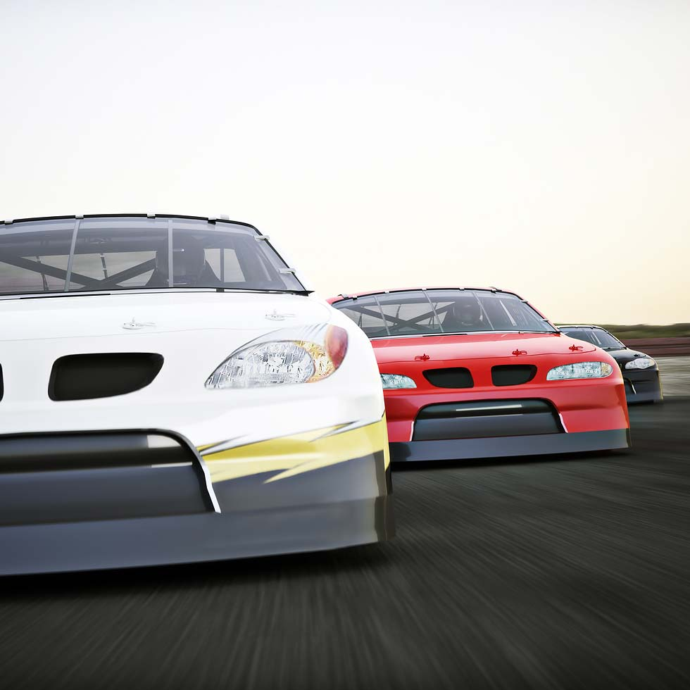 Three Race Cars In White, Red, And Black