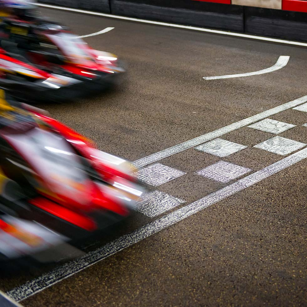 Race Cars Crossing The Finish Line