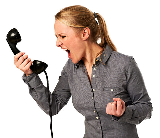 Woman screaming into a phone
